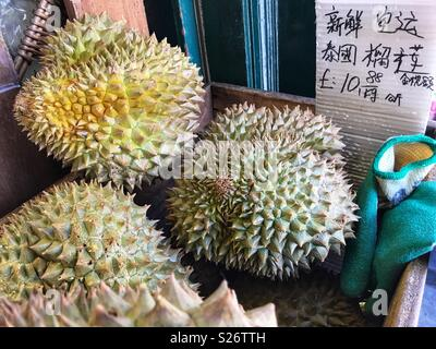 Durians for sale at a Chinese supermarket in Lisle Street, WC2, Chinatown, London, England - Stock Photo