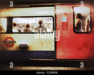 London Underground, People on a Northern Line tube train, Leicester Square tube station, London, England - Stock Photo