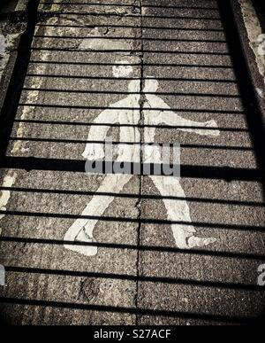 Pedestrian sign on floor with shadow of railings over. Black and white - Stock Photo