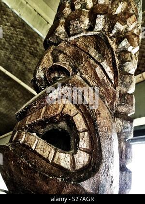 Tiki in Hawaiian hut - Stock Photo