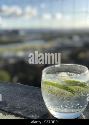 Gin with tonic and lime on a Balcony in Glasgow on a summer evening - Stock Photo