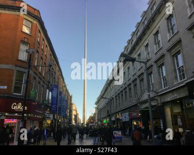 A view of The Spire monument from the Henry Street shopping area. Titled the Monument of Light, it was erected in 2003. Pin like in appearance, it is still considered controversial. - Stock Photo