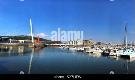 The Swansea Waterfront development with the Sail Bridge over the River Tawe on the left and the marina on the right - Stock Photo