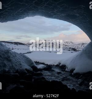 View from inside an ice cave in Iceland - Stock Photo