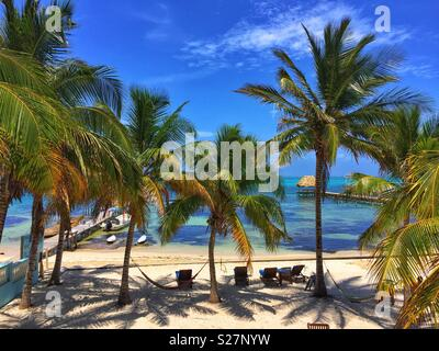 Beach and Pier in Ambergris Caye, Belize - Stock Photo