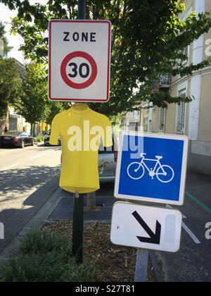 Yellow jersey road decoration on the route of the 2018 Tour de France, Vernon, Normandy, France. - Stock Photo