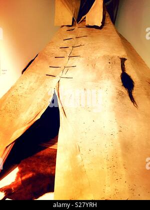Native American teepee on display at the CM Russell museum, Great Falls, Montana, USA - Stock Photo