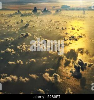 Clouds over the South China Sea in the golden light of late afternoon - Stock Photo
