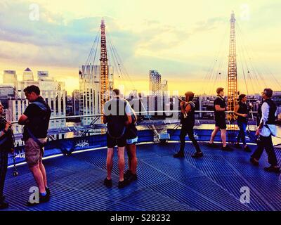 Climbers at top of the O2 (Millenium Dome) roof walk, O2 arena, Greenwich, London - Stock Photo