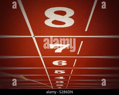 Lane numbers one to eight on race track - Stock Photo