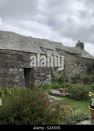 National Trust property Tintagel Old Post Office in Cornwall, UK,  taken from outside in the cottage garden at the back - Stock Photo