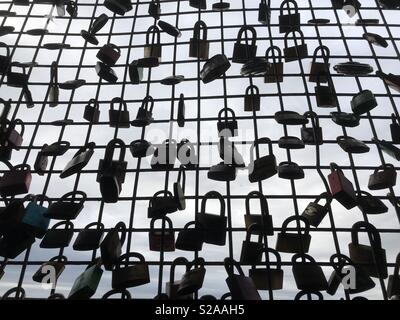 Padlocks on Wire Fence Expressing Love - Stock Photo
