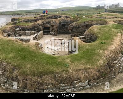 Prehistoric village Skara Brae archaeological site in Sandwick, Orkney, Scotland - Stock Photo