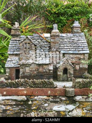 Model of the Old Post Office in the garden at Tintagel village in Cornwall, UK - Stock Photo