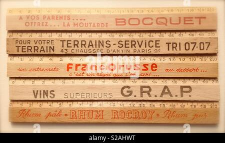A collection of French promotional rulers - Stock Photo
