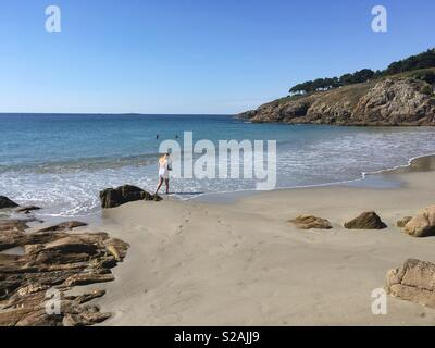 Just a gentle walk on the beach - Stock Photo