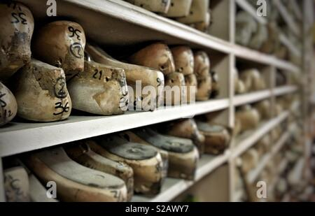 Wooden shoe lasts at a shoemaker in Paris, France - Stock Photo