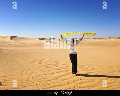 Young woman in desert, Sahara, Egypt - Stock Photo