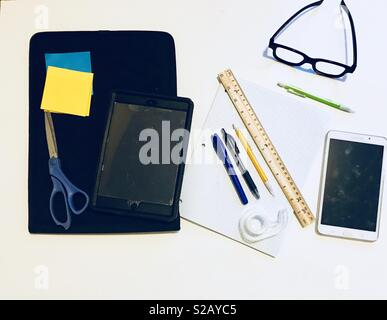 Tools for learning - Business , school , learning , glasses, drawing , art , design - pens, paper , pencils, rulers notepads , post it notes , scissors, iPad - Stock Photo