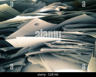 Close up of piles pf papers to be recycled - Stock Photo