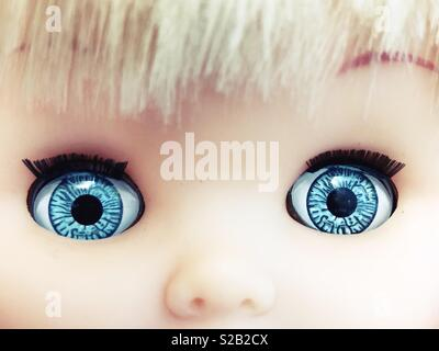 Close up of a doll's big blue eyes. - Stock Photo