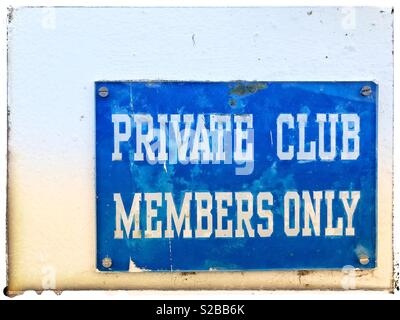 Weathered, blue, metal sign fixed to a wall, which states Private Club Members Only, in white text - Stock Photo