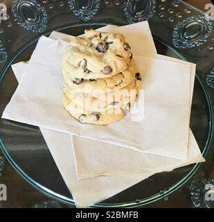 Beautiful and yummy delicious chocolate chip cookies sitting on a plate in the kitchen - Stock Photo