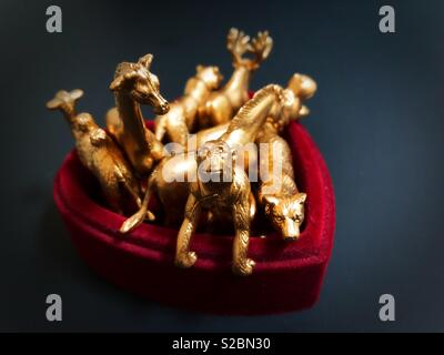 Animal figurines in a box. - Stock Photo