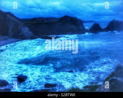 Twilight ocean and rock formation - Stock Photo
