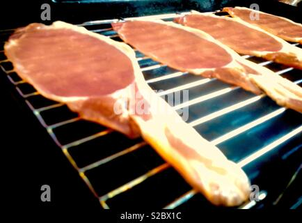 Bacon cooking on a grill pan - Stock Photo