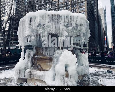 Frozen fountain in Bryant Park New York City - Stock Photo