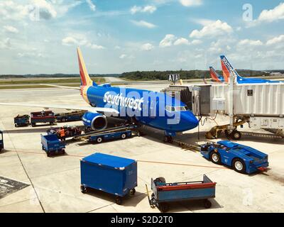 Southwest Airlines plane boarding passengers. - Stock Photo