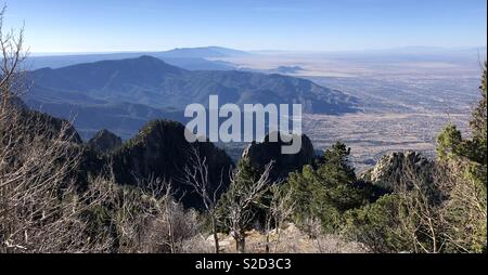 Looking south from Sandia Crest (11,500 feet) over New Mexico with South East Albuquerque in lower right of frame. New Mexico, USA. - Stock Photo