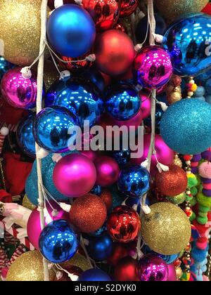 Stringers of beautiful multi color Christmas balls holiday decorations - Stock Photo