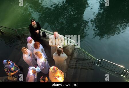 Russian pilgrims at the baptism site at the Jordan river in Israel. - Stock Photo