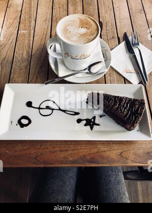 Coffee and sweetest cake in Robert's coffee, Famagusta, Cyprus. - Stock Photo
