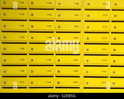Yellow mail boxes - Stock Photo