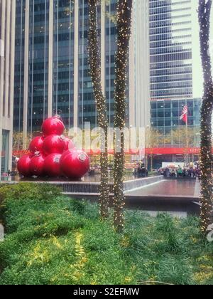 Giant Christmas tree ornament display on Avenue of the Americas during the holiday season, New York City, United States - Stock Photo