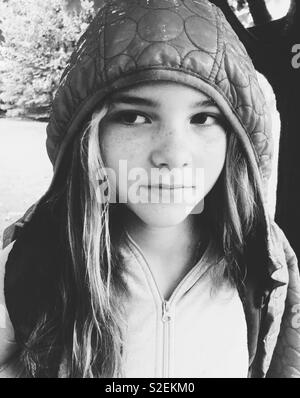 Black and white portrait of tween girl looking to the side - Stock Photo
