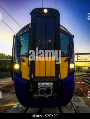 Scotrail Class 385 Hitatchi train at sunrise - Stock Photo