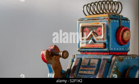 Portrait of vintage tin robot toy - Stock Photo