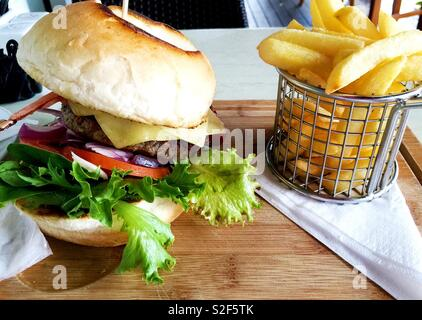 Cheeseburger and fries - Stock Photo