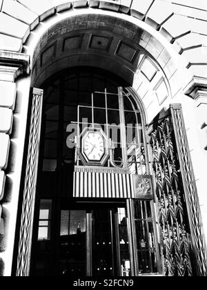1930's Art Deco entrance to Unilever House, Victoria Embankment, London showing the octagonal clock and ornate metalwork - Stock Photo