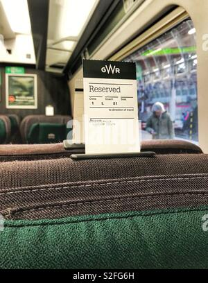 Ticket on the back of a reserved seat on a train operated by Great Western Railway - Stock Photo