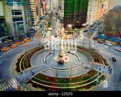 Traffic and pedestrians in Columbus Circle, New York City, USA - Stock Photo