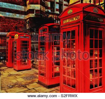 A group of iconic red telephone boxes outside the Royal Courts of Justice in the Strand, London - Stock Photo
