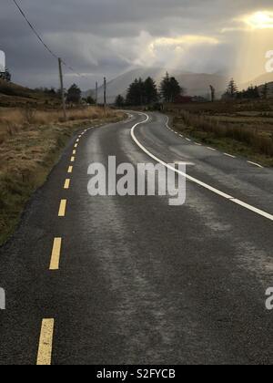 Winding road between Maam Cross and Leenaun, Connemara, County Galway, Ireland - Stock Photo