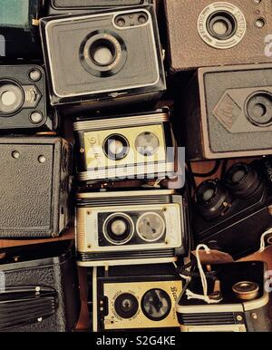 A collection of old film cameras - Stock Photo