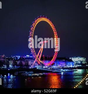 Coca Cola London Eye at Night on South Bank of River Thames - Stock Photo