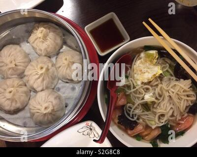 Soup dumplings and Chinese noodles - Stock Photo